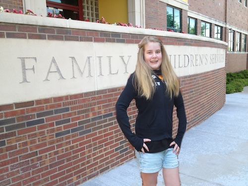 Caitlin outside of Family and Children's services.