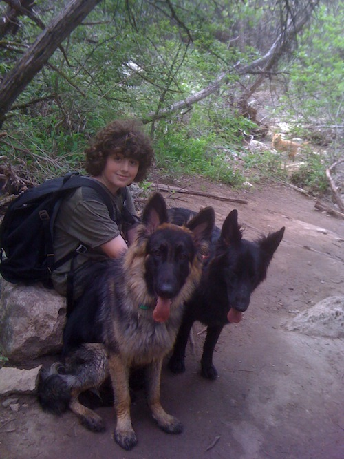 Ranger and Hanna taking a break during a hike in the woods