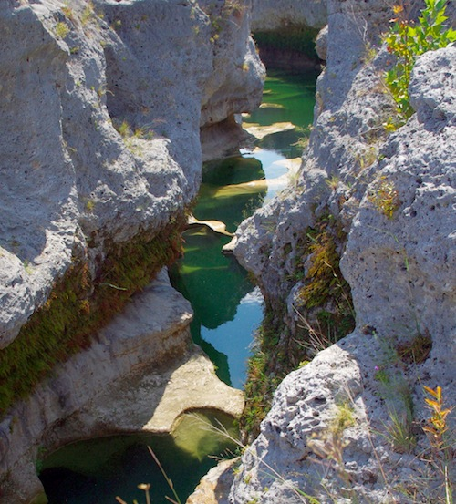 The Blanco River cuts through an exposed fossilized coral reef dating from the Late Cretaceous period.
