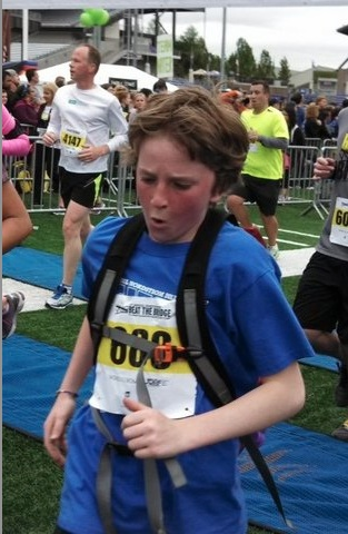 "Sam's mom said ""This is what it looks like to cross the finish line of an 8k race when you have Type 1 diabetes, an insulin pump, a continuous glucose monitor, a backpack full of juice for fear of having a low blood sugar, and more courage in that 12-year old body than I could muster up in all my 46 years. Sam beat the bridge that day, as he always does."""