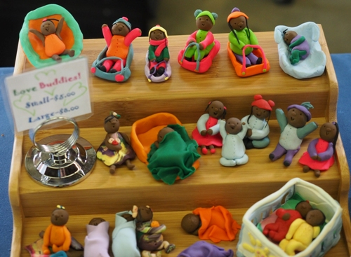 """""""This past year, I've expanded to sell little figures of babies and children I make out of polymer clay,"""" Erin said. """"I call them 'Love Buddies,' and tell people that they are reminders that no child should grow up in poverty."""""""