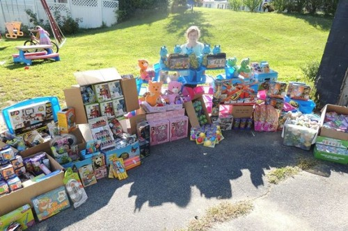 Noelle stands surrounded by the toys she will soon donate to Tufts Floating Hospital. Little actions add up and Noelle is certainly inspiring a very large amount of people.