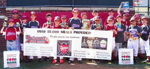 Will Lourcey and his baseball teammates hold up food items they raised for the needy.